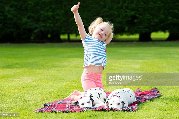 Dalmatians Lying Down With Little Girl