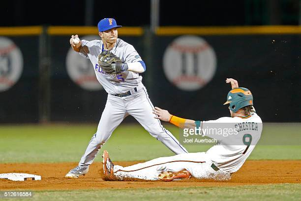 Dalton Guthrie of the Florida Gators turns the double play getting Carl Chester of the Miami Hurricanes out at second base on February 26 2016 at...