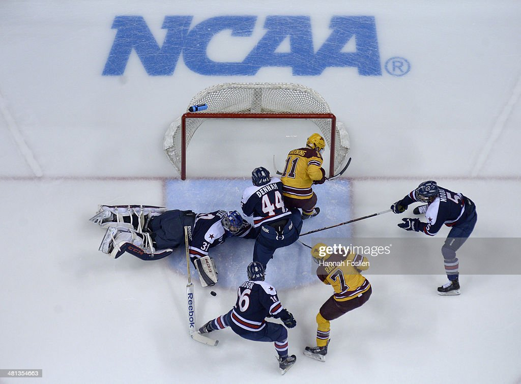Dalton Izyk of the Robert Morris Colonials blocks a shot by the Minnesota Golden Gophers during the second period of the West Regional game of the...