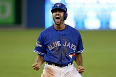 Dalton Pompey of the Toronto Blue Jays celebrates after sliding into third base in the seventh inning against the Texas Rangers in game five of the...