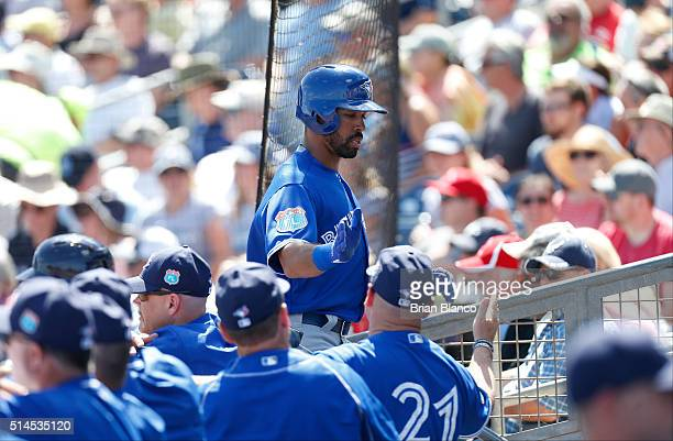 Dalton Pompey of the Toronto Blue Jays celebrates with teammates after scoring off of a wild pitch by Chris Archer of the Tampa Bay Rays during the...