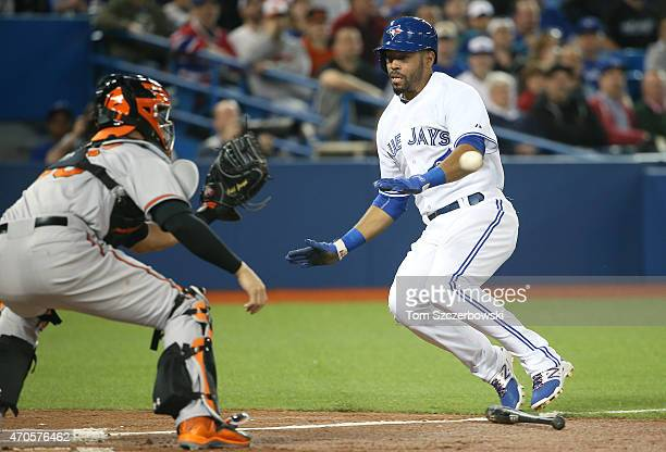 Dalton Pompey of the Toronto Blue Jays slides safely into home plate to score a run in the second inning during MLB game as Caleb Joseph of the...