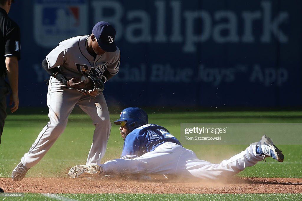 Dalton Pompey #45 of the Toronto Blue Jays steals second base in the eighth inning during MLB game action as Tim Beckham #1 of the Tampa Bay Rays takes the throw on September 27, 2015 at Rogers Centre in Toronto, Ontario, Canada.
