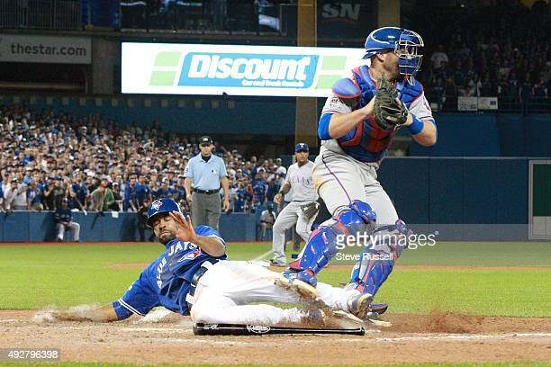Dalton Pompey pinch running for Russell Martin is forced out at home as he slides into home catching the foot of catcher Chris Gimenez The Toronto...