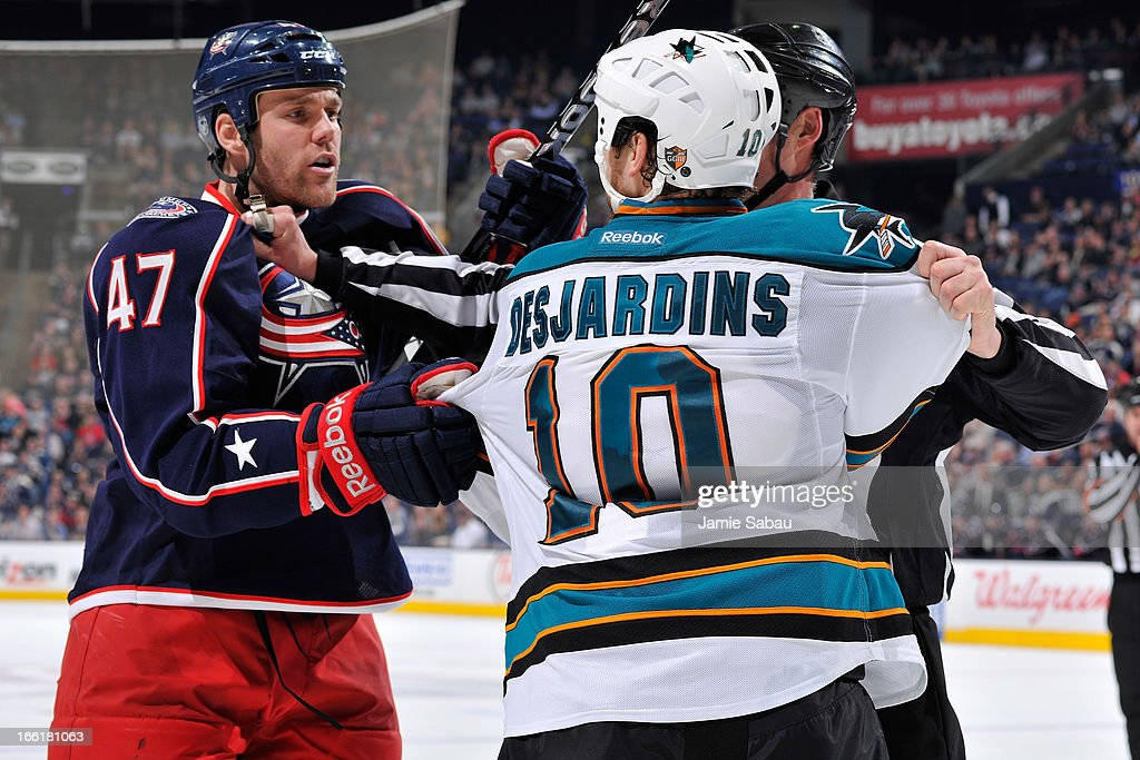 <a gi-track='captionPersonalityLinkClicked' href=/galleries/search?phrase=Dalton+Prout&family=editorial&specificpeople=6263673 ng-click='$event.stopPropagation()'>Dalton Prout</a> #47 of the Columbus Blue Jackets and <a gi-track='captionPersonalityLinkClicked' href=/galleries/search?phrase=Andrew+Desjardins&family=editorial&specificpeople=2748431 ng-click='$event.stopPropagation()'>Andrew Desjardins</a> #10 of the San Jose Sharks exchange words during the third period on April 9, 2013 at Nationwide Arena in Columbus, Ohio. Columbus defeated San Jose 4-0.