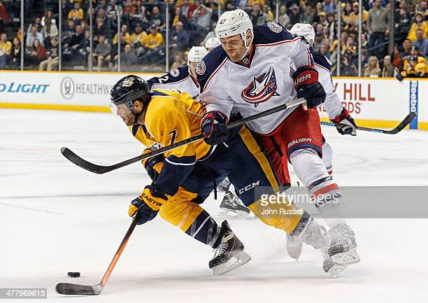 Dalton Prout of the Columbus Blue Jackets battles against Matt Cullen of the Nashville Predators at Bridgestone Arena on March 8 2014 in Nashville...