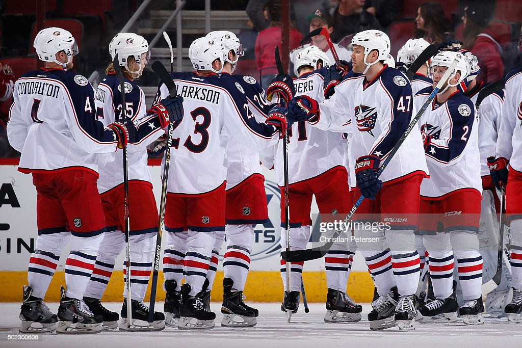 Dalton Prout of the Columbus Blue Jackets highfives David Clarkson and William Karlsson following the NHL game against the Arizona Coyotes at Gila...