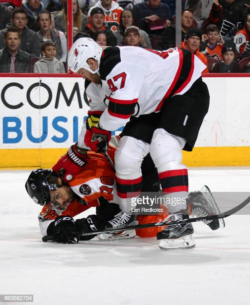 Dalton Prout of the New Jersey Devils checks PierreEdouard Bellemare of the Philadelphia Flyers to the ice on April 1 2017 at the Wells Fargo Center...