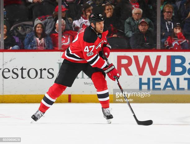 Dalton Prout of the New Jersey Devils plays the puck against the Columbus Blue Jackets during the game at Prudential Center on March 19 2017 in...