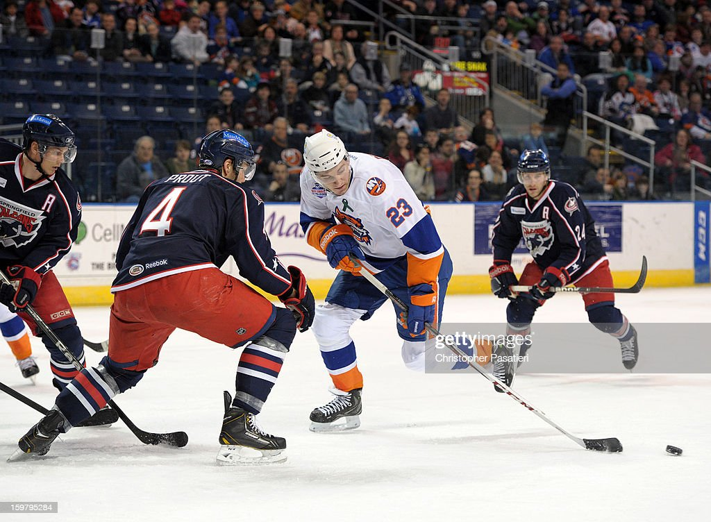 Dalton Prout #4 of the Springfield Falcons and John Persson #23 of the Bridgeport Sound Tigers skate after the puck during an American Hockey League game on January 20, 2013 at the Webster Bank Arena at Harbor Yard in Bridgeport, Connecticut.