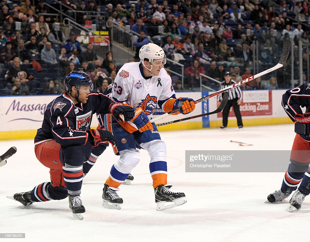 Dalton Prout #4 of the Springfield Falcons holds off John Persson #23 of the Bridgeport Sound Tigers after losing his stick during an American Hockey League game on January 20, 2013 at the Webster Bank Arena at Harbor Yard in Bridgeport, Connecticut.