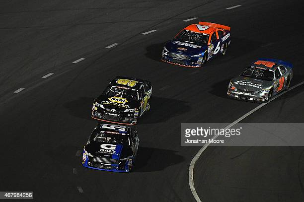 Dalton Sargeant driver of the GALT Ford leads a pack of cars during the Napa Auto Parts 150 at Kern County Raceway Park on March 28 2015 in...