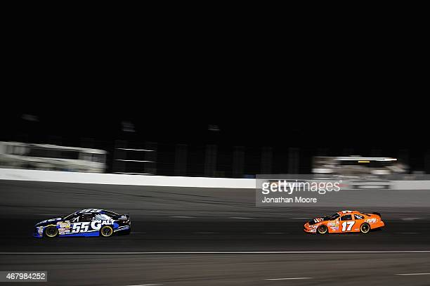 Dalton Sargeant driver of the GALT Ford leads against David Mayhew driver of the MMI Service/Ron's Rear Ends/Pour House Chevrolet during practice for...