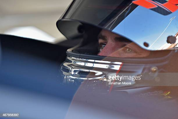 Dalton Sargeant driver of the GALT Ford sits in his car during qualifying for the Napa Auto Parts 150 at Kern County Raceway Park on March 28 2015 in...