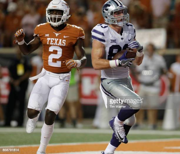 Dalton Schoen of the Kansas State Wildcats catches a pass for a touchdown in the second quarter defended by Kris Boyd of the Texas Longhorns at...