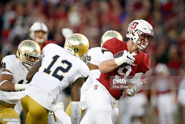 Dalton Schultz of the Stanford Cardinal makes a reception during their game against the Notre Dame Fighting Irish at Stanford Stadium on November 28...