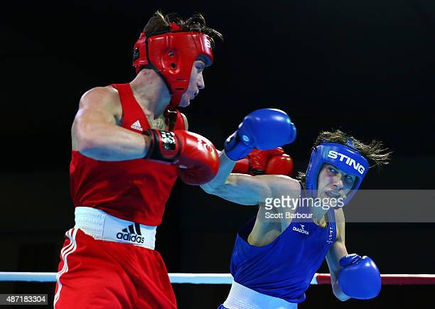 Dalton Smith of England and Harrison Garside of Australia box during the Youth's Light 60kg Boxing at the Tuanaimato Sports Facility on day one of...