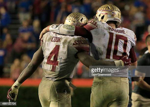 Dalvin Cook and Sean Maguire of the Florida State Seminoles celebrate following the Seminoles 272 victory over the Florida Gators at Ben Hill Griffin...