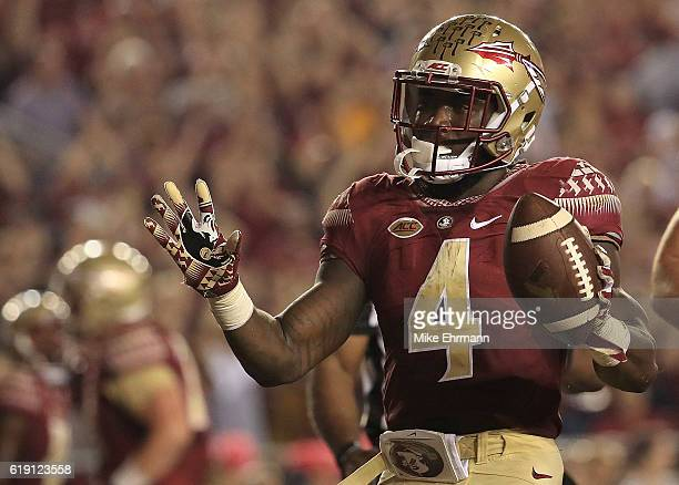 Dalvin Cook of the Florida State Seminoles celebrates a touchdown during a game against the Clemson Tigers at Doak Campbell Stadium on October 29...