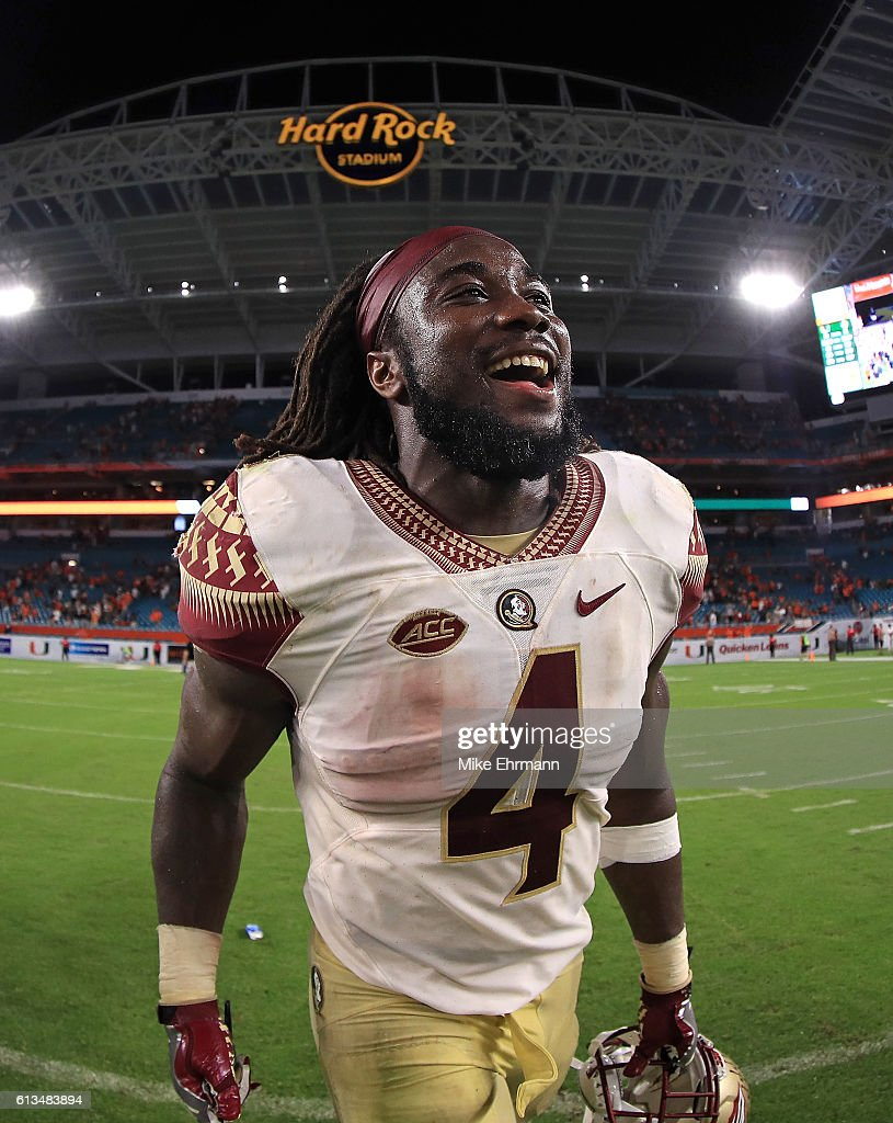 Dalvin Cook #4 of the Florida State Seminoles celebrates after a game against the Miami Hurricanes at Hard Rock Stadium on October 8, 2016 in Miami Gardens, Florida.
