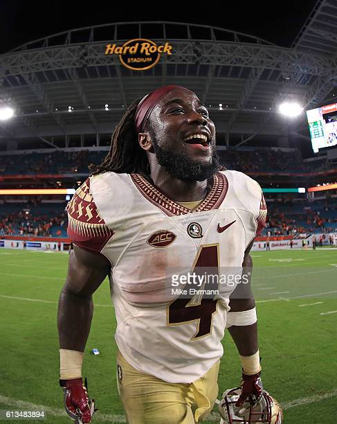 Dalvin Cook of the Florida State Seminoles celebrates after a game against the Miami Hurricanes at Hard Rock Stadium on October 8 2016 in Miami...