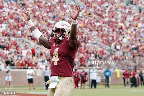 Dalvin Cook of the Florida State Seminoles celebrates against the South Florida Bulls during a game at Doak Campbell Stadium on September 12 2015 in...