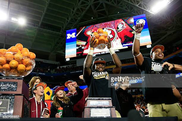 Dalvin Cook of the Florida State Seminoles celebrates their 33 to 32 win over the Michigan Wolverines during the Capitol One Orange Bowl at Sun Life...