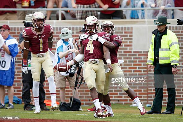 Dalvin Cook of the Florida State Seminoles celebrates with teammates after running for a 74yard touchdown against the South Florida Bulls in the...