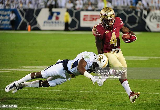 Dalvin Cook of the Florida State Seminoles evades the tackle attempt by Step Durham of the Georgia Tech Yellow Jackets on October 24 2015 at Bobby...