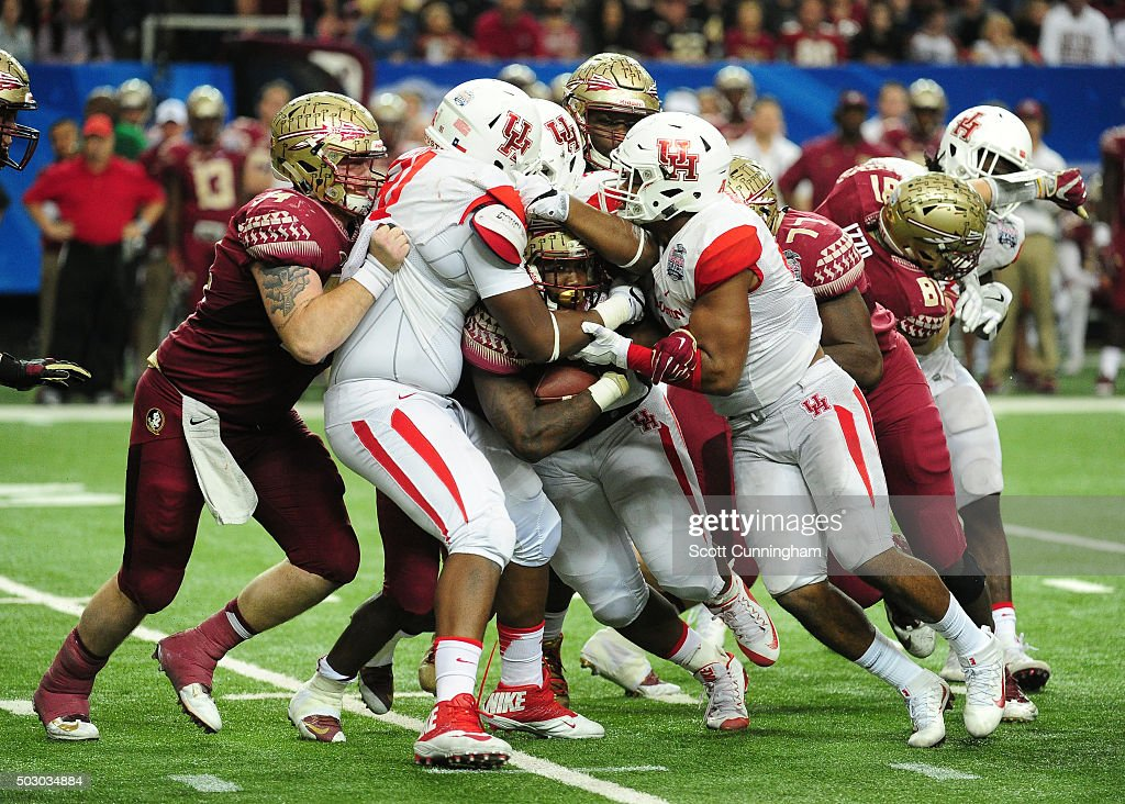 Dalvin Cook #4 of the Florida State Seminoles is tackled by Nick Thurman #91, Elandon Roberts #44, and Jerard Carter #52 of the Houston Cougars during the Chick-Fil-A Peach Bowl at the Georgia Dome on December 31, 2015 in Atlanta, Georgia. Photo by Scott Cunningham/Getty Images)
