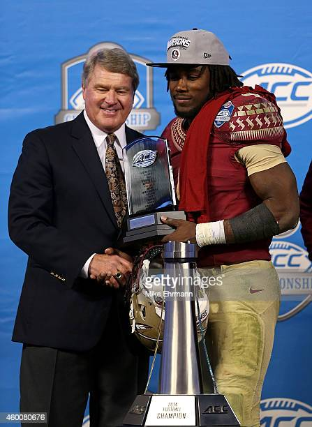 Dalvin Cook of the Florida State Seminoles recieves the MVP trophy after their 3735 victory over the Georgia Tech Yellow Jackets at the ACC...