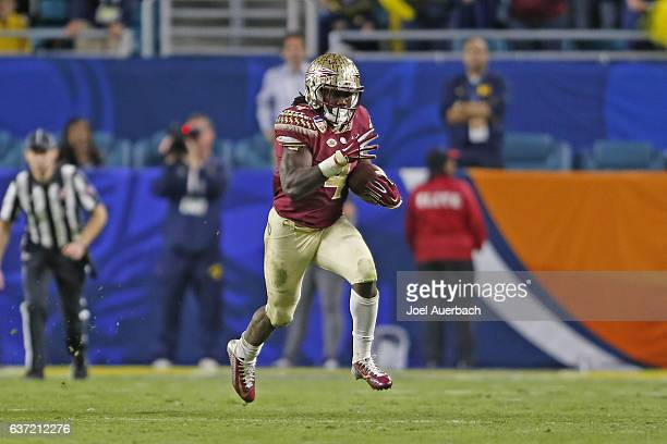 Dalvin Cook of the Florida State Seminoles runs for 71 yards against the Michigan Wolverines during during fourth quarter action at the 2016 Capital...