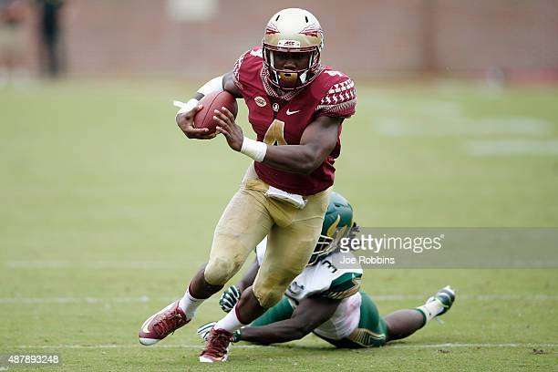 Dalvin Cook of the Florida State Seminoles runs for a 24yard touchdown against the South Florida Bulls in the third quarter at Doak Campbell Stadium...