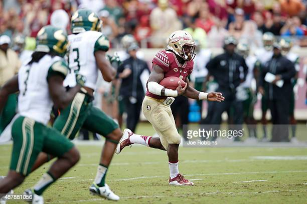 Dalvin Cook of the Florida State Seminoles runs for a 74yard touchdown against the South Florida Bulls in the first quarter at Doak Campbell Stadium...