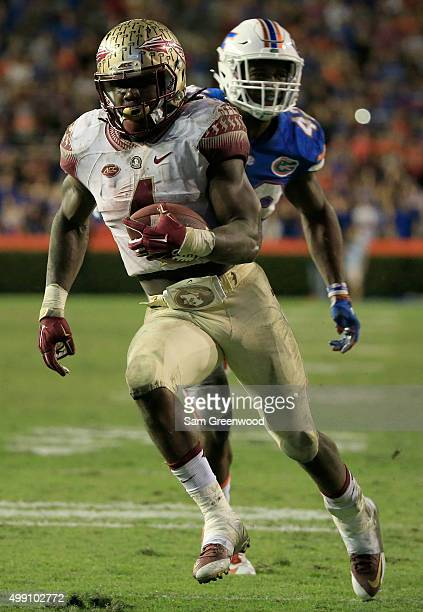 Dalvin Cook of the Florida State Seminoles runs for a touchdown during the game against the Florida Gators at Ben Hill Griffin Stadium on November 28...