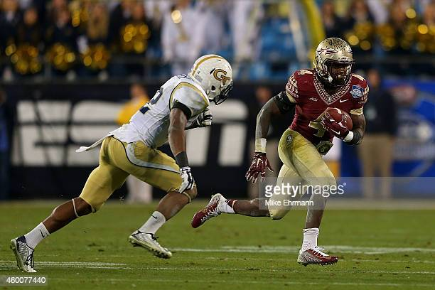 Dalvin Cook of the Florida State Seminoles runs the ball against Demond Smith of the Georgia Tech Yellow Jackets in the 3rd quarter during the ACC...