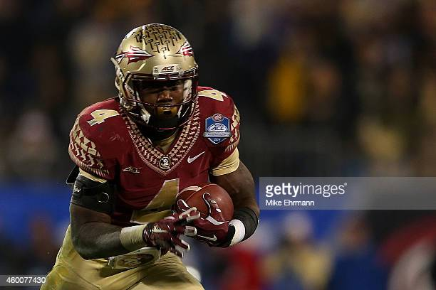 Dalvin Cook of the Florida State Seminoles runs the ball against the Georgia Tech Yellow Jackets in the 3rd quarter during the ACC Championship game...