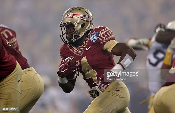 Dalvin Cook of the Florida State Seminoles runs the ball agasint the Georgia Tech Yellow Jackets in the 1st quarter during the ACC Championship game...