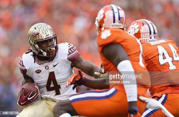 Dalvin Cook of the Florida State Seminoles runs with the ball against the Clemson Tigers during their game at Memorial Stadium on November 7 2015 in...