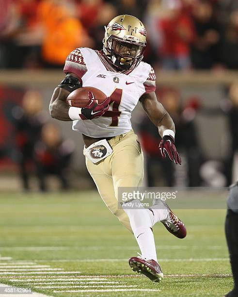 Dalvin Cook of the Florida State Seminoles runs with the ball during the game against the Louisville Cardinals at Papa John's Cardinal Stadium on...