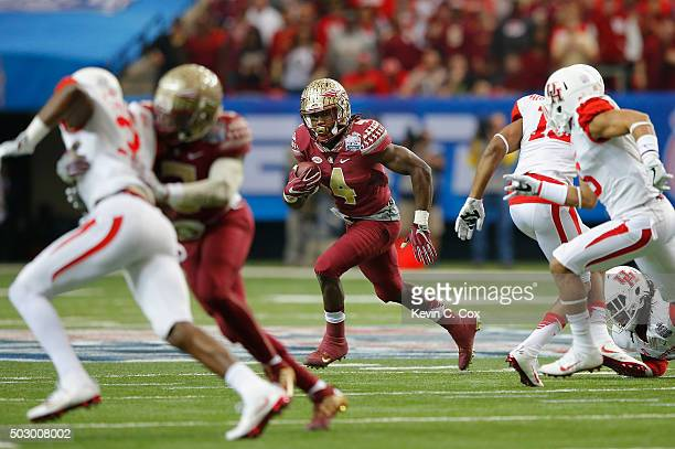 Dalvin Cook of the Florida State Seminoles rushes against the Houston Cougars in the first quarter during the ChickfilA Peach Bowl at the Georgia...