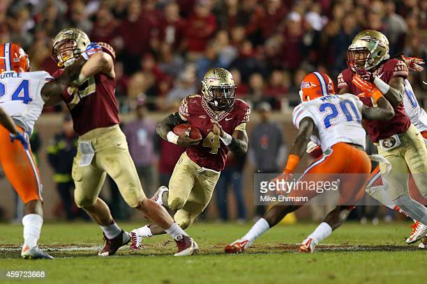 Dalvin Cook of the Florida State Seminoles rushes during a game against the Florida Gators at Doak Campbell Stadium on November 29 2014 in...