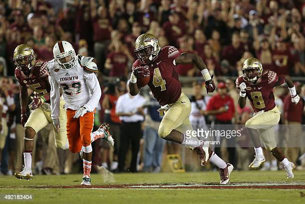 Dalvin Cook of the Florida State Seminoles rushes during a game against the Miami Hurricanes at Doak Campbell Stadium on October 10 2015 in...