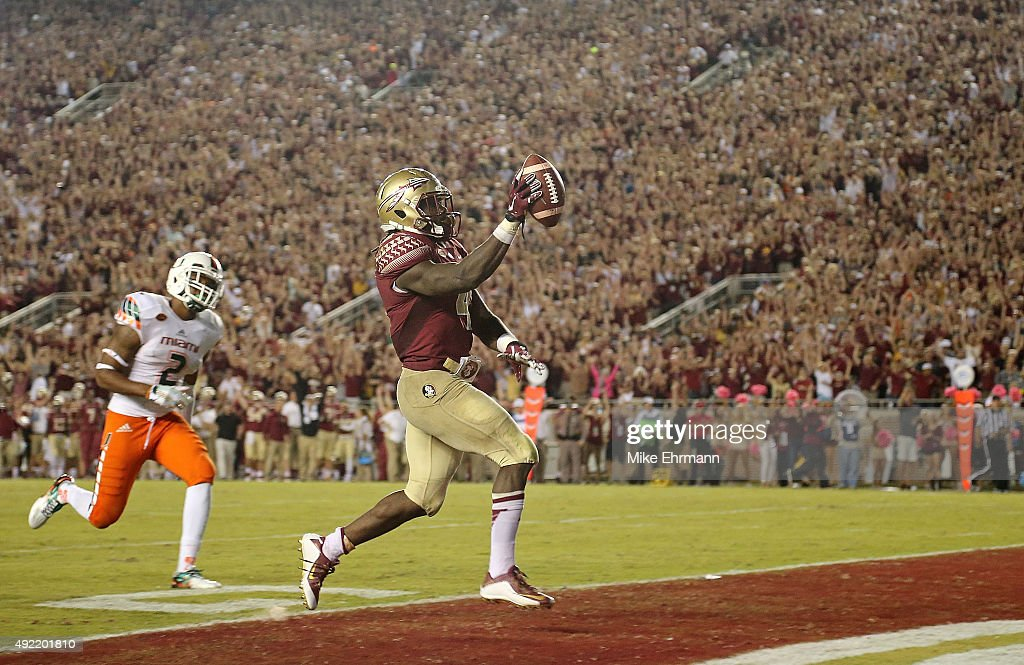 Dalvin Cook #4 of the Florida State Seminoles rushes for a touchdown during a game against the Miami Hurricanes at Doak Campbell Stadium on October 10, 2015 in Tallahassee, Florida.