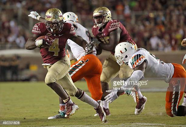 Dalvin Cook of the Florida State Seminoles rushes for a touchdown during a game against the Miami Hurricanes at Doak Campbell Stadium on October 10...