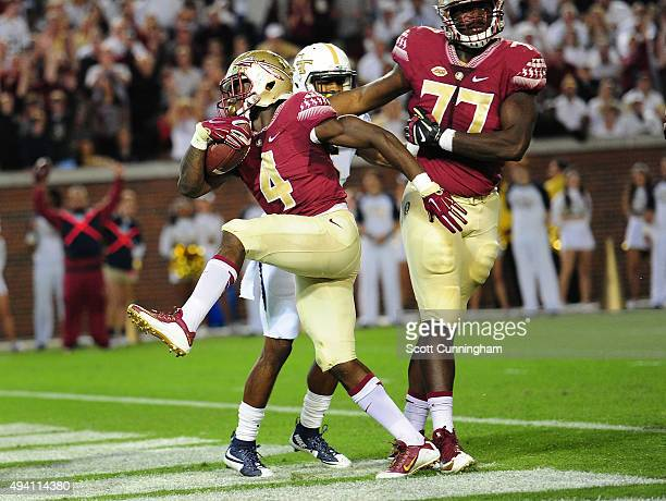 Dalvin Cook of the Florida State Seminoles scores a first half touchdown against the Georgia Tech Yellow Jackets on October 24 2015 at Bobby Dodd...