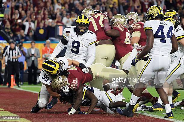 Dalvin Cook of the Florida State Seminoles scores a touchdown in the first quarter against the Michigan Wolverines during the Capitol One Orange Bowl...