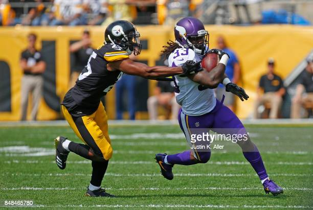 Dalvin Cook of the Minnesota Vikings rushes against Artie Burns of the Pittsburgh Steelers in the first quarter during the game at Heinz Field on...