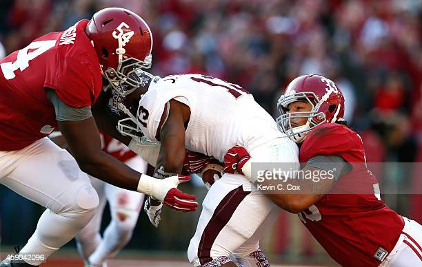 Dalvin Tomlinson and Trey DePriest of the Alabama Crimson Tide force a safety as they tackle Josh Robinson of the Mississippi State Bulldogs in the...