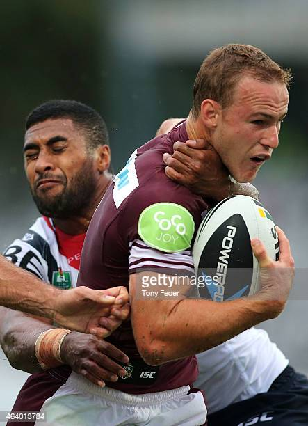 Daly Cherry Evans of the Sea Eagles is tackled by the Roosters defence during the NRL Trial Match between the Sydney Roosters and the Manly Sea...